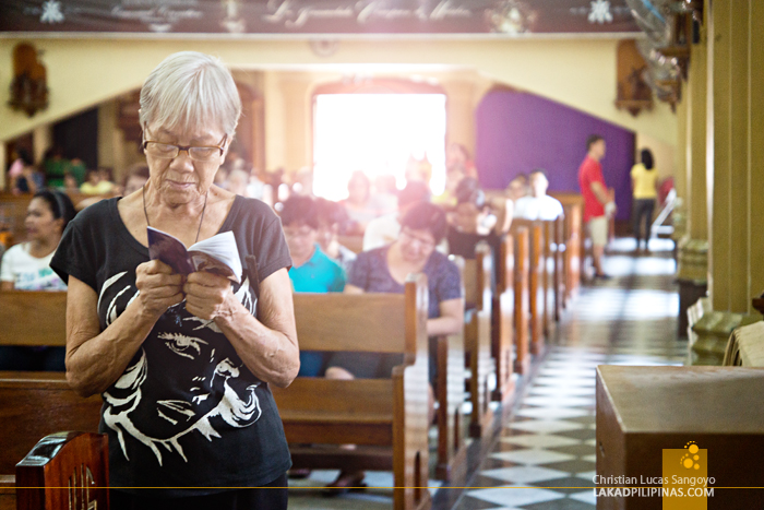 An Old Lady Praying the Station of the Cross at Our Lady of Conception Church in Malabon