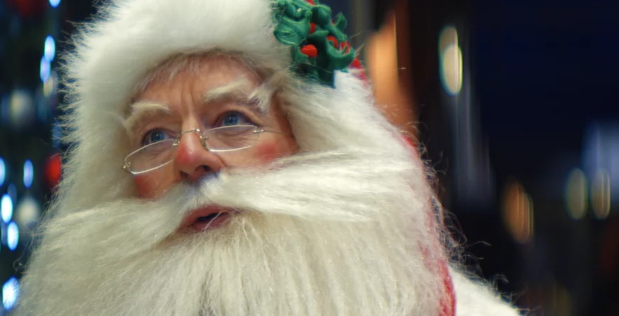 Watch Santa Claus Share A KitKat Break With Random Strangers In The UK