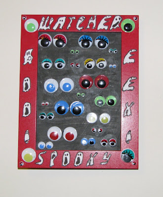 Googly eyes art on picture frame