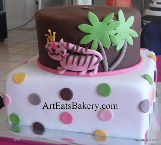 Pink tiger, palm trees and polka dots creative custom fondant baby shower cake. It was done to match the invitation