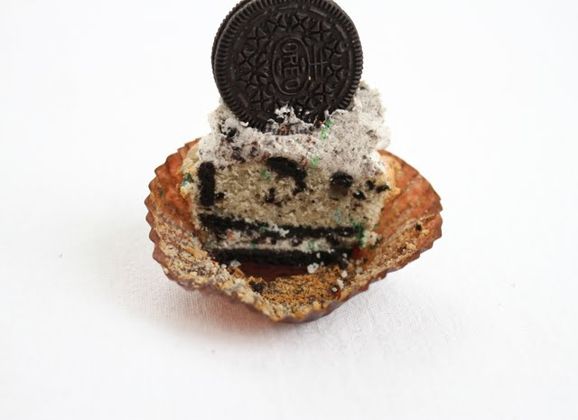 photo of a cupcake sliced in half to show the layers inside