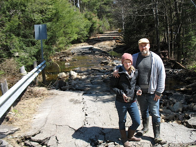 Johnny & Alissa Ahsome checking out the extent of damage to Lambert rd., which they live on.