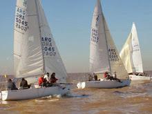 J/24 sailboats- sailing on Rio de la Plata, Argentina- off Buenos Aires