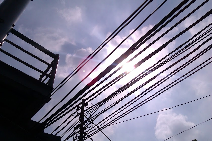 The Sun behind Line Cables