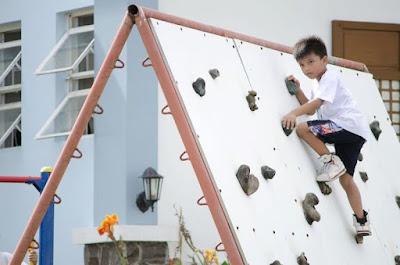 Zach rock climbing