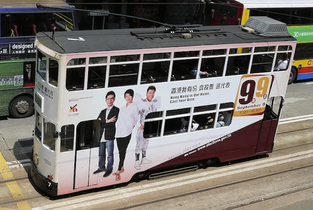 tram in Hong Kong with advertising encouraging people to vote