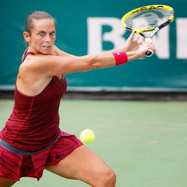 Roberta Vinci of Italy hits a return to Caroline Wozniacki of Denmark during their Istanbul Cup women's singles final tennis match in Istanbul, July 20, 2014.