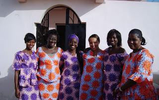 Tostan staff dressed in matching outfits at the International Women's Day Celebration at Liberté VI Women's Correctional Facility in Dakar.