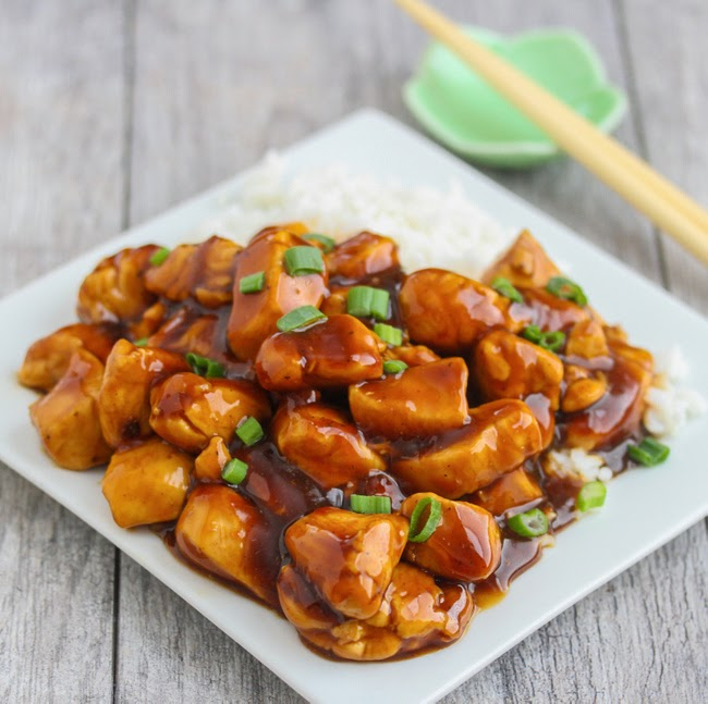 photo of a plate of orange chicken