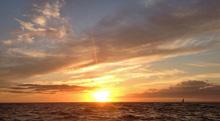 J/105 sailing sunset on round ireland race