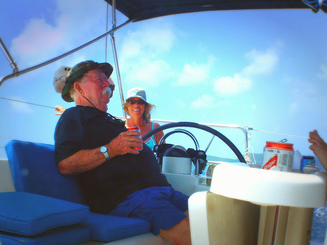 It's time to kick back a little... Arthur and Janet enjoying the afternoon sail.