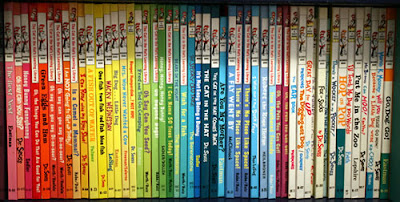 Dr. Seuss books arranged with spines in color spectrum order