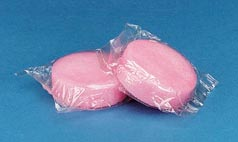 two pink urinal cakes wrapped in cellophane