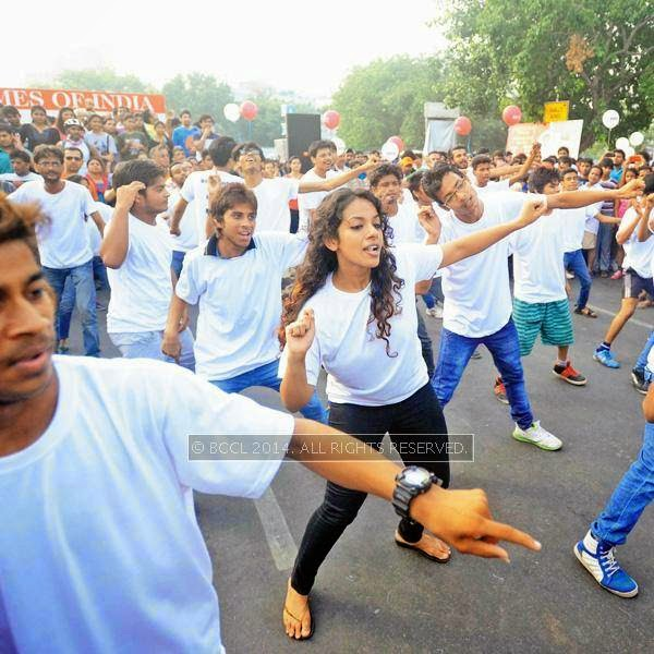 Members of Studens For Peace surprise the crowd with their flash mob during the Raahgiri Day, held at Connaught Place's Inner Circle, in New Delhi.