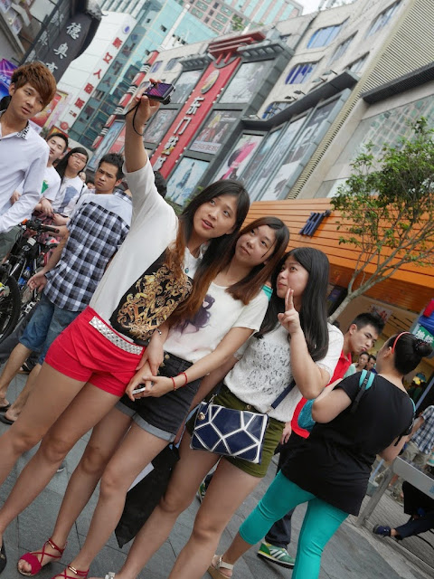 three young women talking a selfie at Dongmen