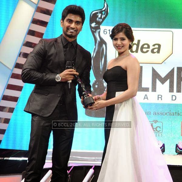 Samantha presents the Best Actor Award for male in Tamil to Adharva for his performance in the film 'Paradesi' during the 61st Idea Filmfare Awards South, held at Jawaharlal Nehru Stadium in Chennai, on July 12, 2014.