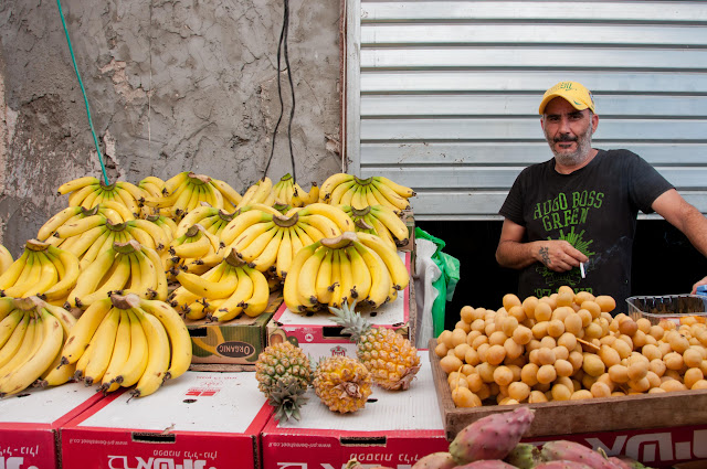 banana vendor, Ramle Market, outdoor market