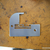Globe and White Overlocker Needle Plate Repair