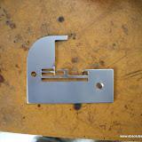 Globe and White Overlocker Needle Plate Repair