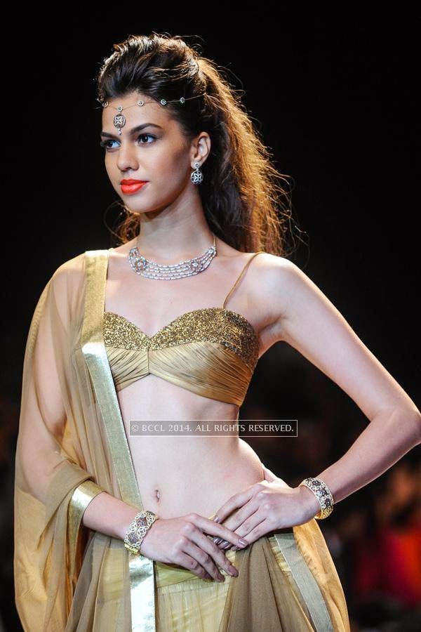 A model walks the ramp for Nazraana by Rio Tinto on Day 3 of India International Jewellery Week (IIJW), 2014, held at Grand Hyatt, in Mumbai.