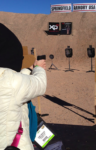gabby%20shooting%20XDs%209mm%20at%20SHOTShow%202013