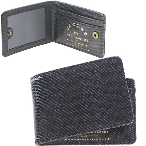 Marc by Marc Jacobs Denim Snap Wallet New, Denim Indigo. 100% Laminated Cotton. 100% Authentic. Size: 4 x 2.5 inches, Interior features: snap, 2 Slot Pockets, 1 ID Slot, 1 Inside Sleeve Pocket, Gold Jacobs by Marc Jacobs motif.