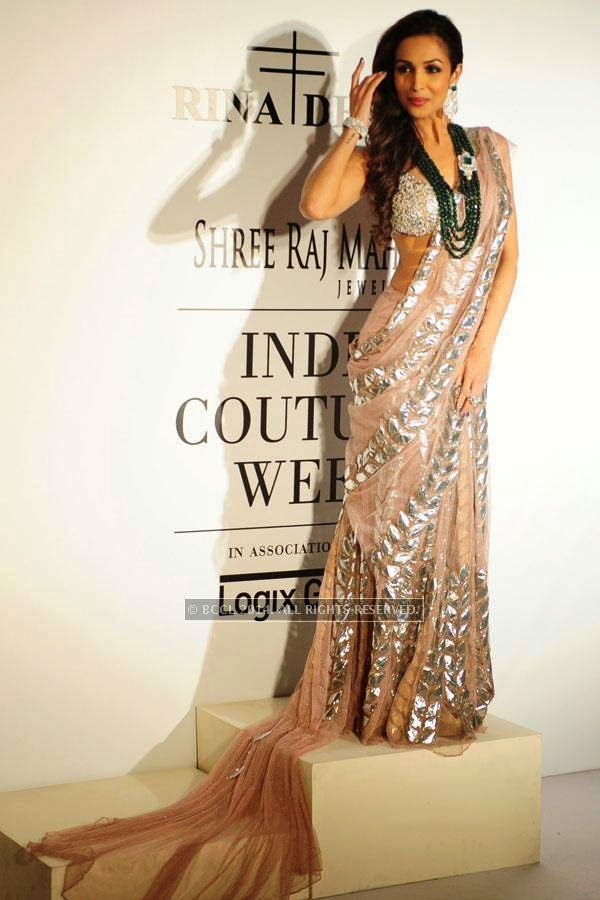 Malaika Arora Khan poses for Rina Dhaka on Day 2 of India Couture Week, 2014, held at Taj Palace hotel, New Delhi.