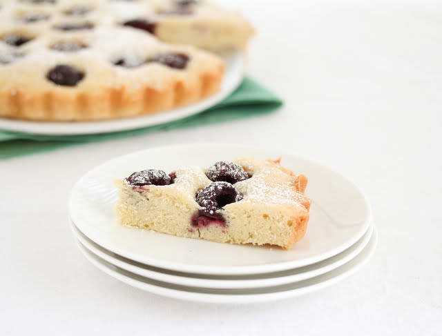 photo of a slice of cherry cake on a plate