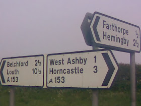 A153 roadsign with several suspect Saxon suffixes