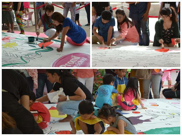 Bernadette Allyson, Dimples Romana, Hamzah and Cj de Silva painting the mural