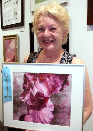 """Honorable Mention: """"Representing Red"""" by Linda Wilmes. Watercolor."""