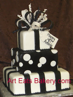 Four tier square presents custom black and white 40th birthday cake with stripes, polka dots and sugar bow