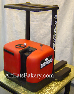 Custom unique red and black 3D forklift retirement cake from the steering platform