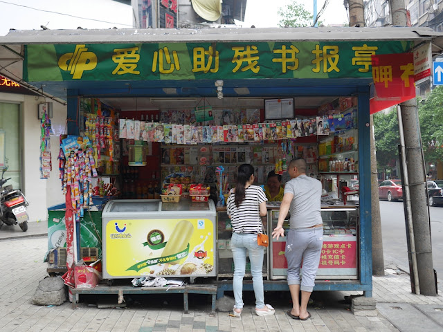 people at a newspaper stand in Hengyang, Hunan, China