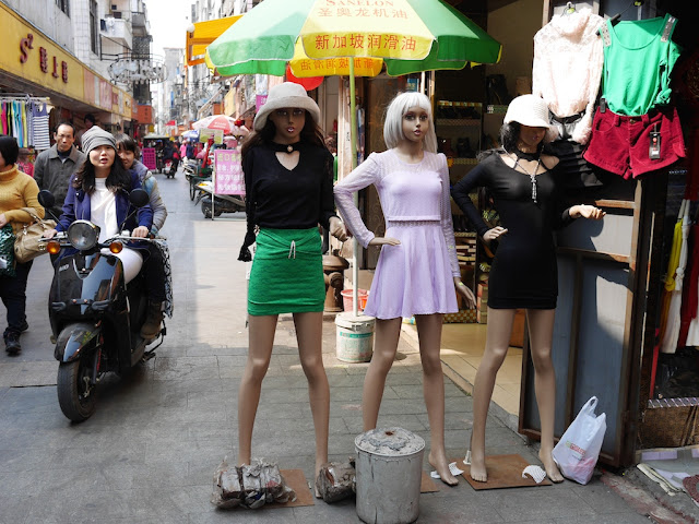 mannequins and two young women on a motorbike in Yangjiang, China