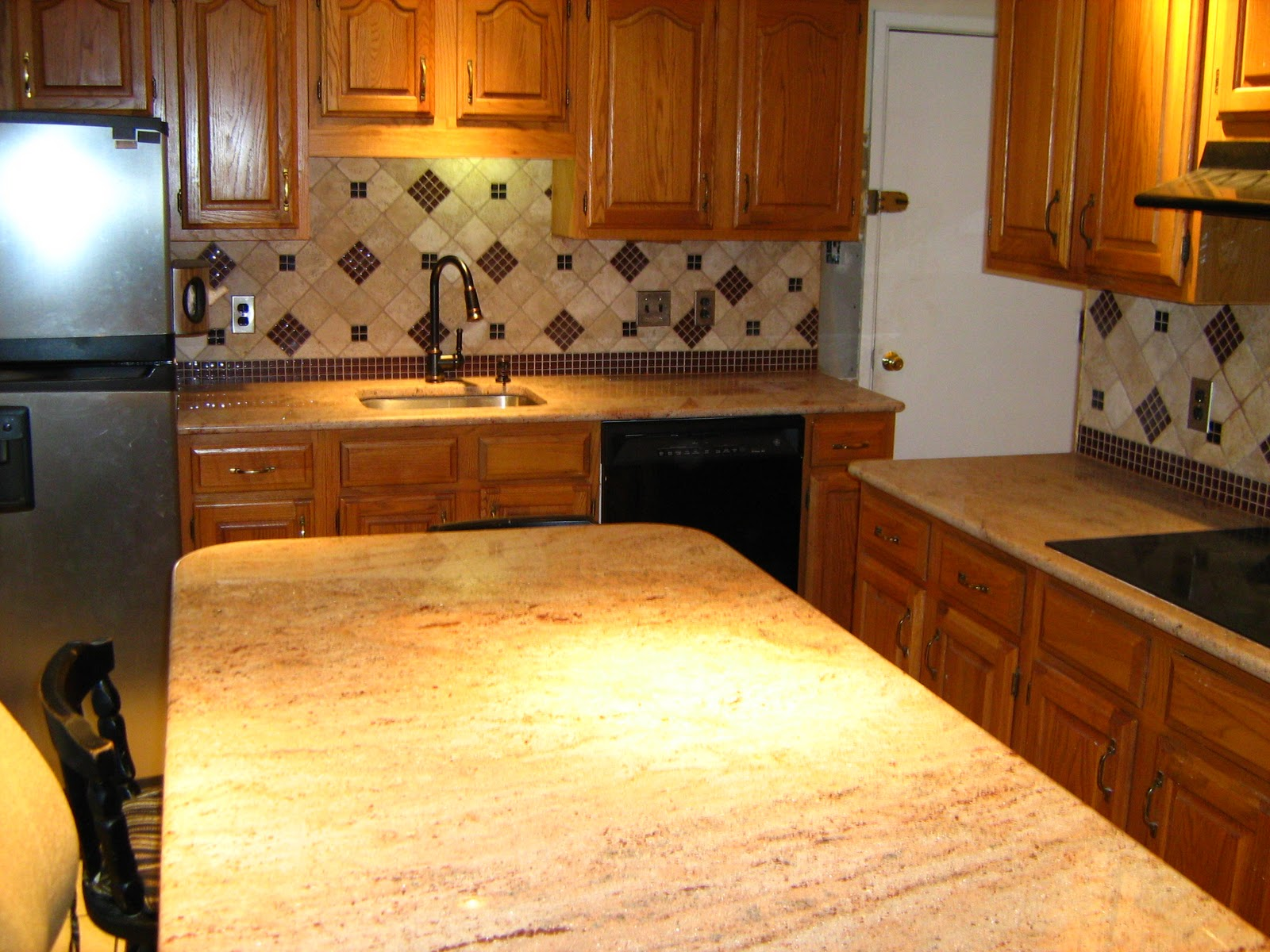 We Provided Granite Slab Countertops And With Julia And Alexu0027s Assistance  On The Tile Backsplash Design, Created A Beautiful Kitchen.