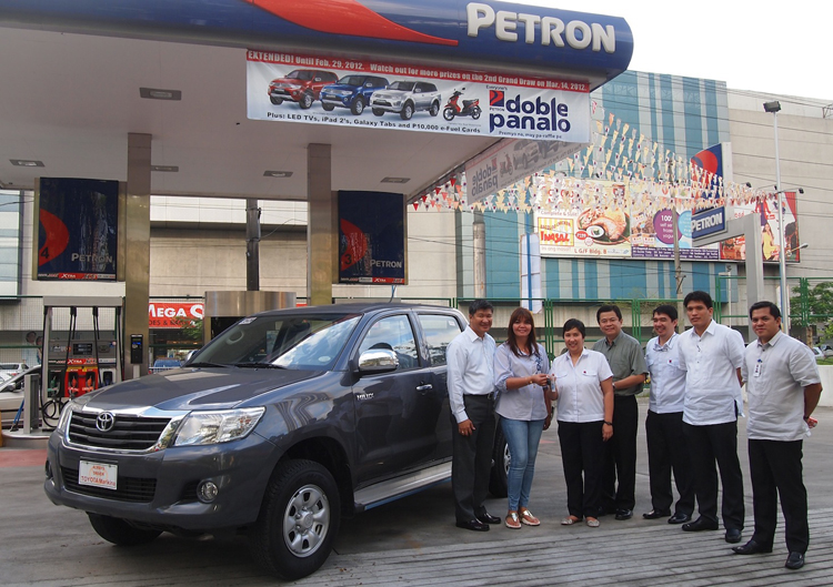 Petron turns over vehicles to Doble Panalo promo winners