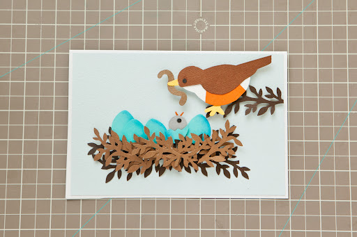 To complete card, use glue stick to adhere the completed mat to a folded piece of white card stock.