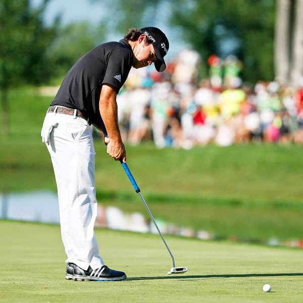 Brian Harman putts on the 18th green during the final round of the John Deere Classic, held at TPC Deere Run, on July 13, 2014, in Silvis, Illinois.