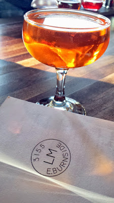 Laurelhurst Market specialty cocktail courtesy of Kevin Ludwig of the Pine Tar Incident with Pear Brandy, Genepy, Aperol. Sweet Vermouth