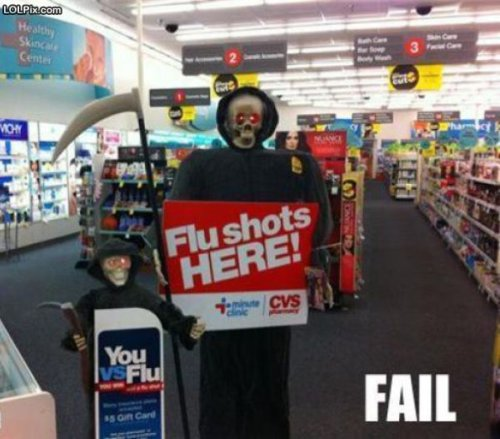 photo of Death holding a flu shot here sign