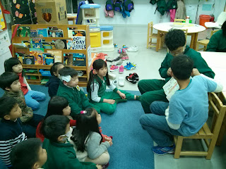 Jacob and Austin read to the ASLA Kindergarten class.