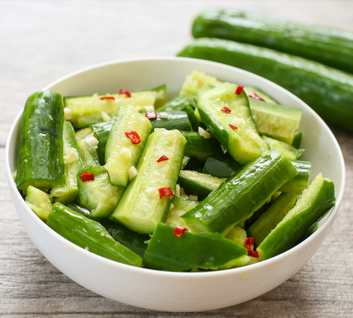 smashed cucumber salad tossed in the dressing