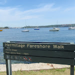 Sign and water views at Hermit Point (254264)