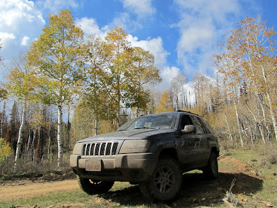 Muddy Jeep parked at the head of Seeley Canyon