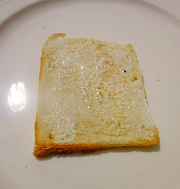 Slice of bread with mayonnaise