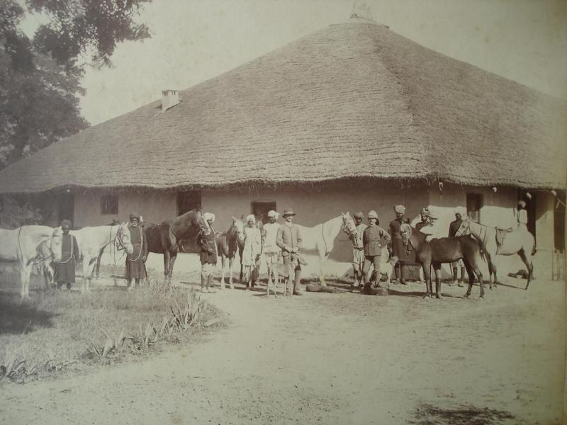 Soldiers with Indian Servants in front of a Thatched House - 1887