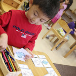 This boy at our Irvine preschool campus near Westpark is making his own booklet of the parts of a fish.
