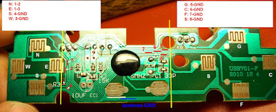 The original board from a cheap chinese USB gamepad controller (5$). In yellow the cutting lines and in red the traces to be connected with the external switches.