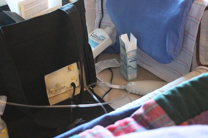 a breast pump in a cosleeping bassinet